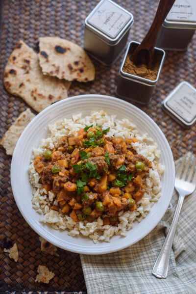 This ground beef curry is perfect for family dinner! Sweet potatoes and onions stretch the ground beef and with mild spices even the kids love it!