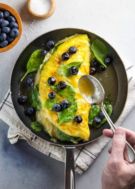 Souffle Omelette with spinach artichokes and brie