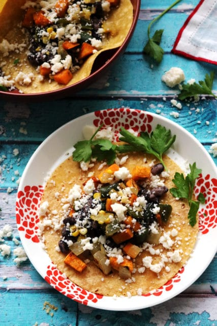 soft corn tacos with roasted sweet potatoes, poblano peppers and corn