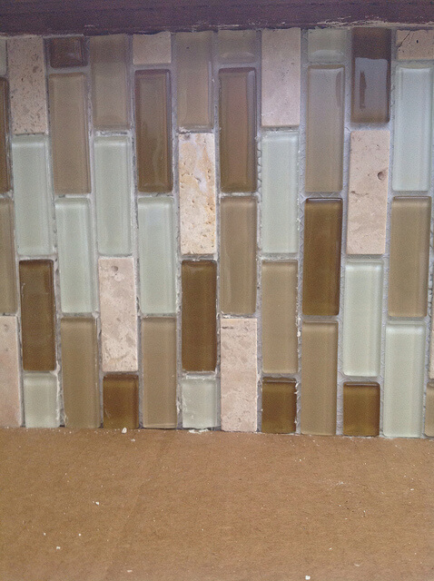 How to tile a glass mosaic backsplash over paneling the for Can you paint glass tile