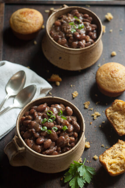 Dry pinto beans and chunks of ham or ham hocks cook all day long with plenty of seasonings in your slow cooker for the perfect dinner. Perfect with homemade cornbread!