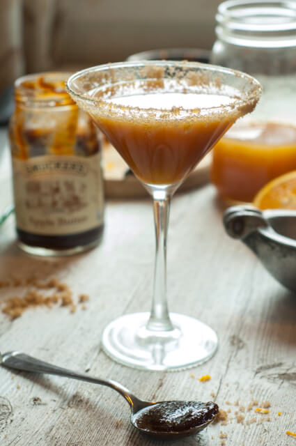 Apple cider meets a shot of bourbon and they shake things up with apple butter, fresh orange & lime juice and spices.