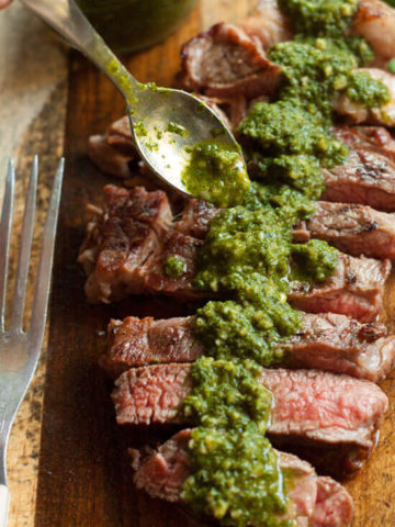Chimichurri Sauce--A traditional Argentinian sauce served with barbecued meats. Perfect stirred into soups, spread on grilled cheese or tossed with pasta.