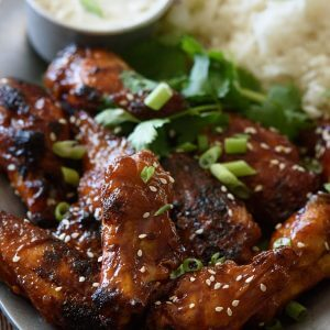 The Best Crispy Oven Baked Chicken Wings with Sticky Honey Garlic Sauce