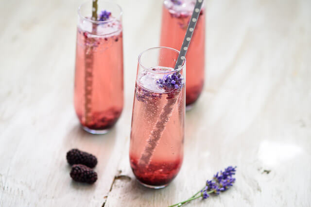 This champagne cocktail gets a unique twist with a simple blackberry and lavender sauce that is super easy but looks stunning! Perfect for entertaining with delicious real ingredients.