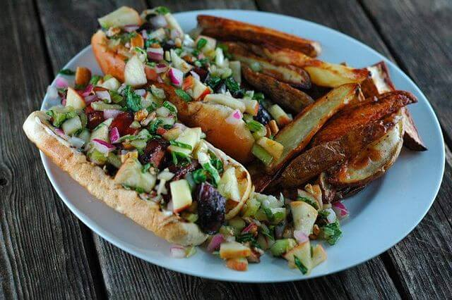 The Perfect Summer Slaw: This recipe uses bok choi, apples, red onions and pecans paired with a tangy dressing to make a bright cruchy slaw. Perfect alone, with sausages or on fish tacos! | www.TheAdventureBite.com