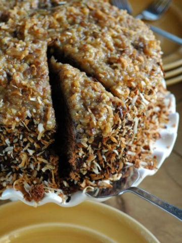 Toasted Coconut German Chocolate Cake Recipe. Toasting the coconut and adding rum to the frostings take this cake to a whole new level! | www.TheAdventureBite.com